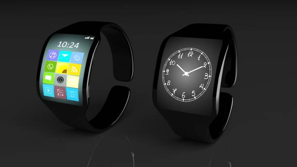 Two smartwatches with apps and clock on screen, isolated on black background. stock photo