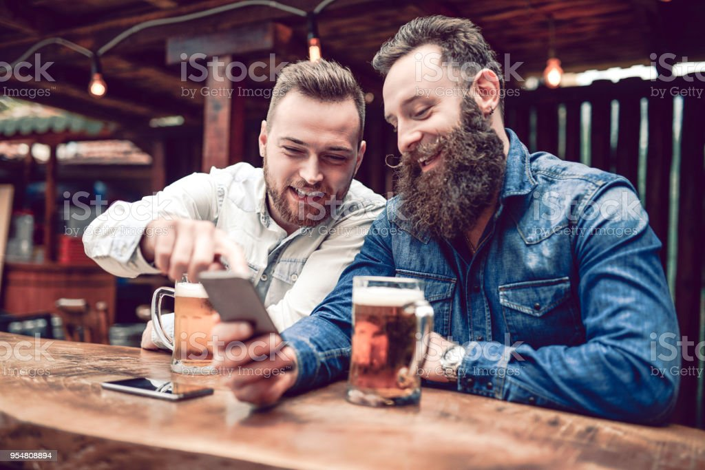 Adult Mobile Stock Istock Two Phone And Smiling Hipster Using Beer More Friends Drinking Pictures Bearded amp; Photo Of -