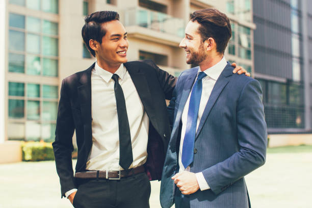 Two Smiling Business Men Friends Outdoors stock photo