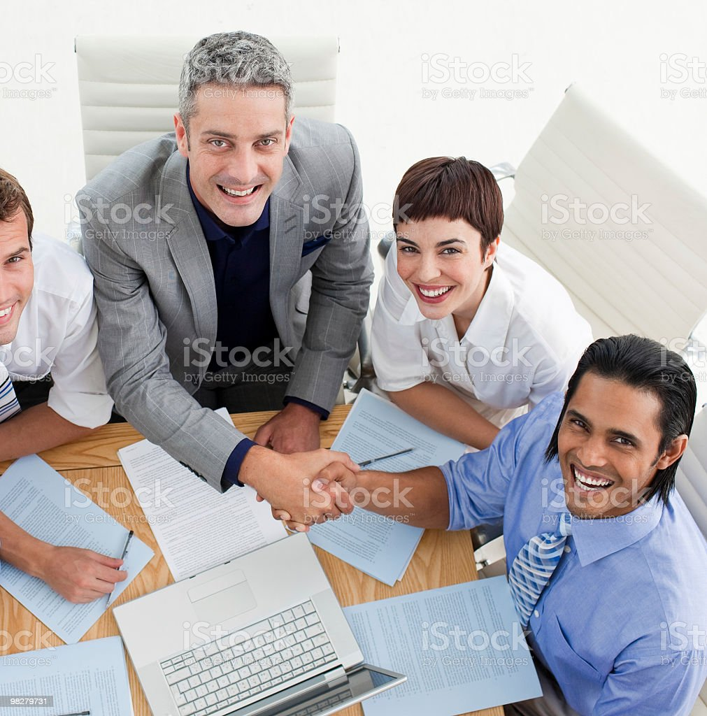 Two smiling business people greeting each other royalty-free stock photo