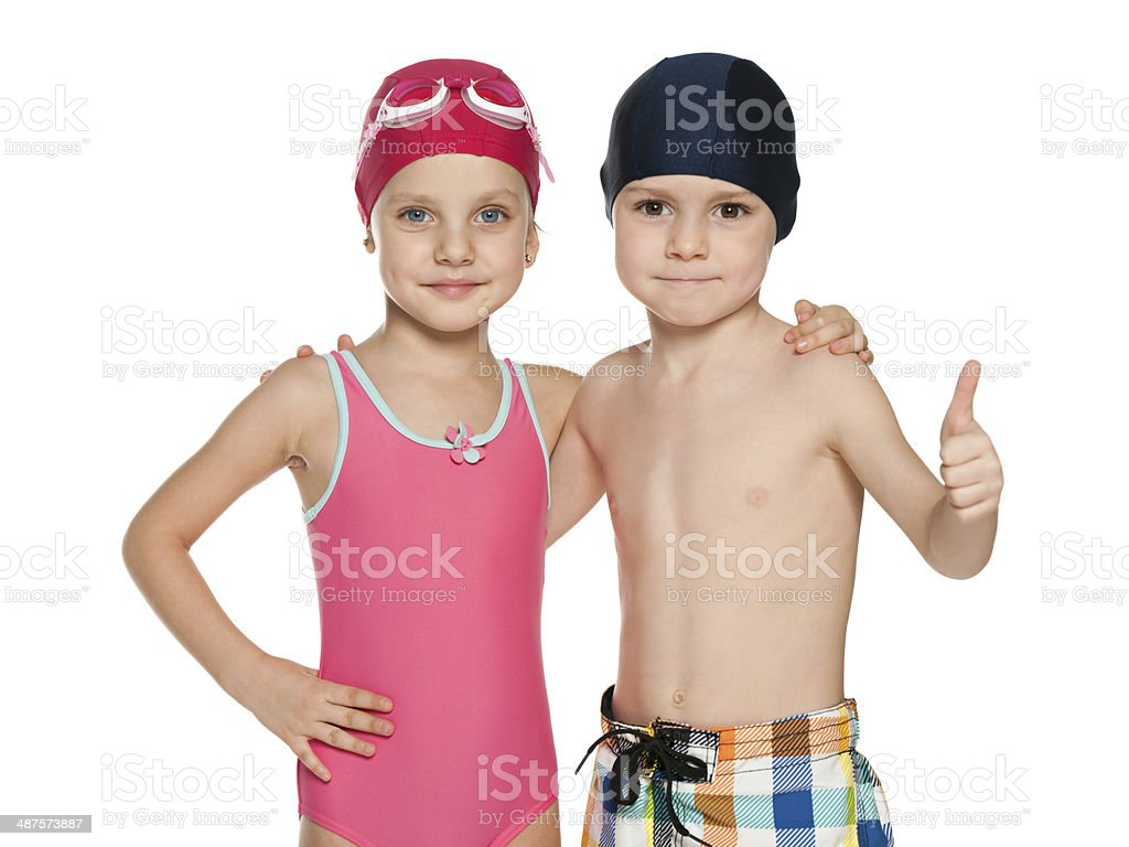 Two smiling children in swimsuits stock photo