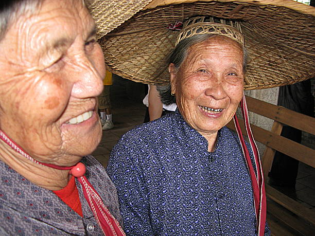 two smiling chinese women in local costume - gold tooth stock photos and pictures