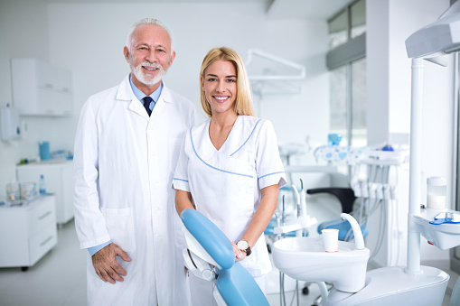 Two Smiling Dentists In A Dental Office Stock Photo & More Pictures of Adult