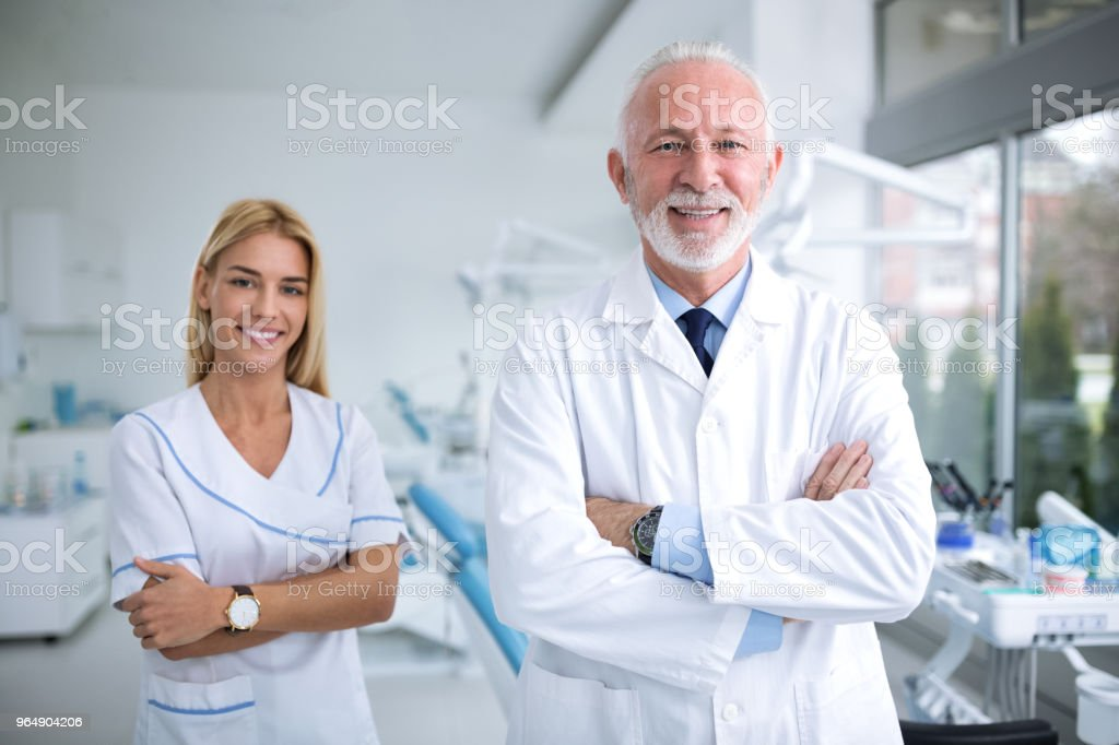 Two smiling dentists in a dental office - Royalty-free Adult Stock Photo