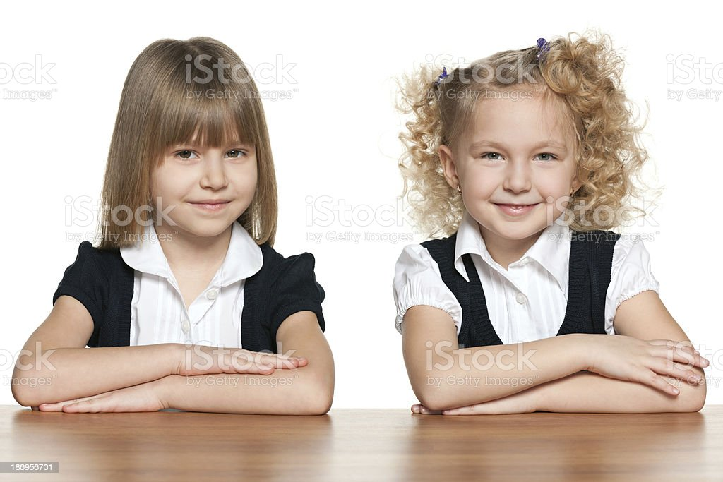 Two smiling girls at the desk royalty-free stock photo