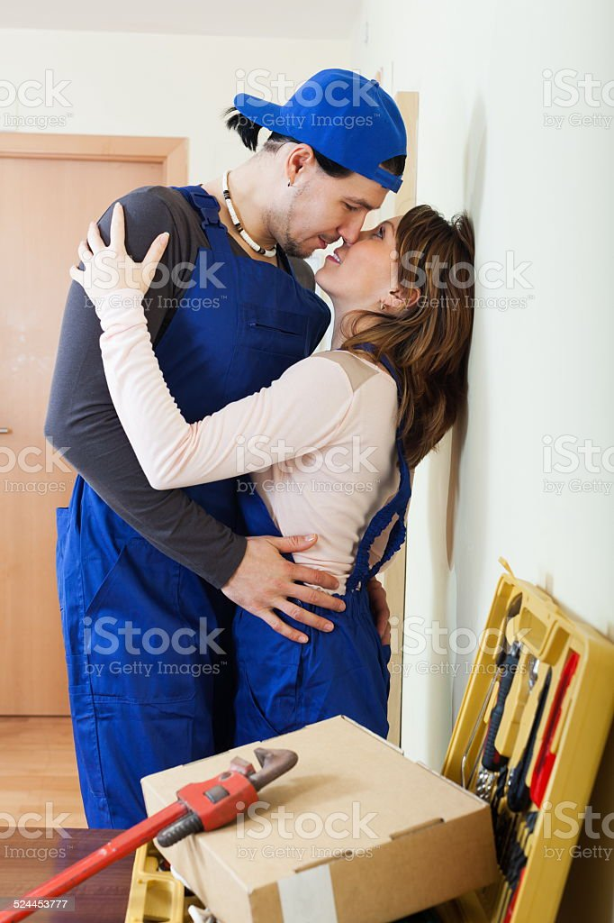 Two smiling workers flirting stock photo