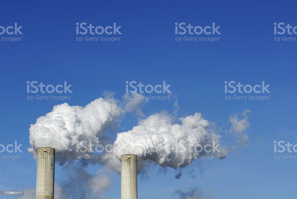 Two smoke stacks royalty-free stock photo