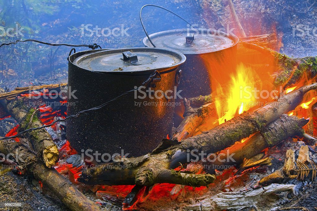 two smoke tourist kettle on fire royalty-free stock photo