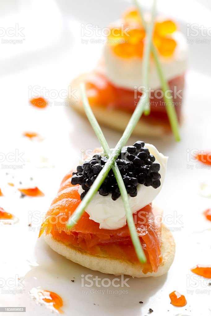 Two smoked salmon and caviar canapes stock photo