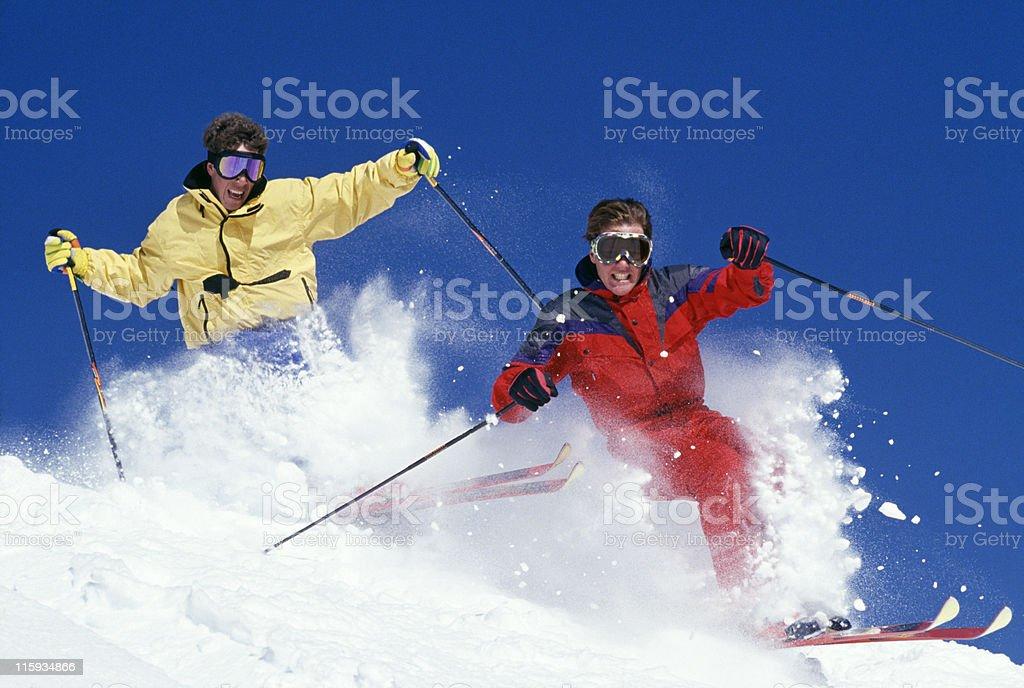 Two Snow Skiers Blasting Through Fresh Powder royalty-free stock photo