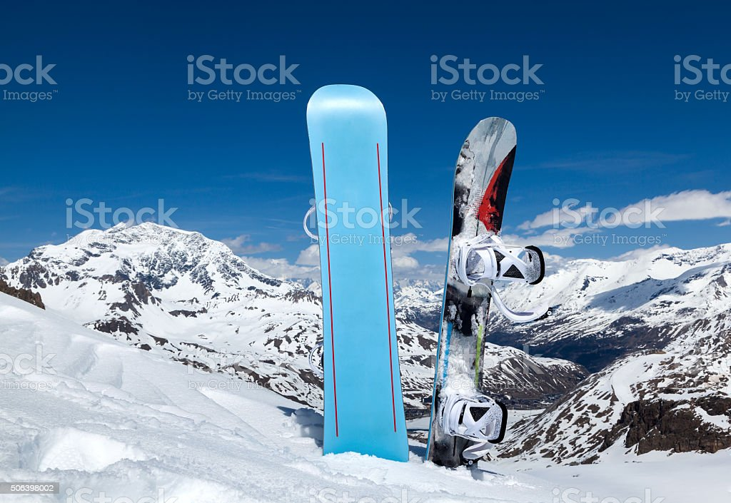 Two snowboard standing upright in snow stock photo