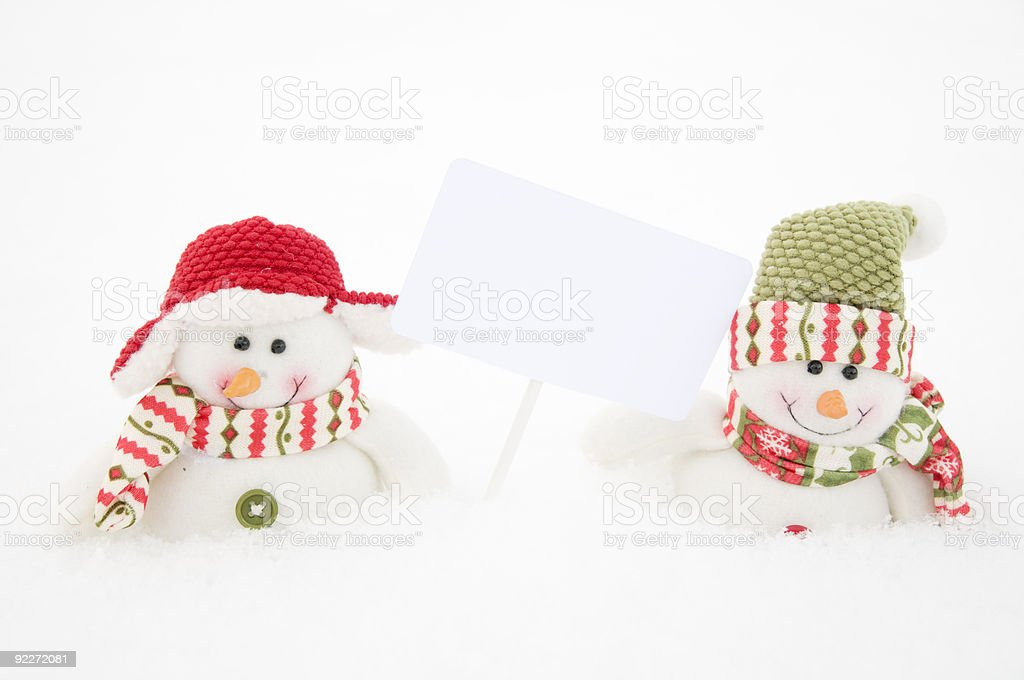Two snowman with sign royalty-free stock photo