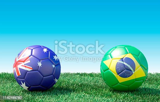 istock Two soccer balls in flags colors on green grass. Australia and Brazil 1140199782
