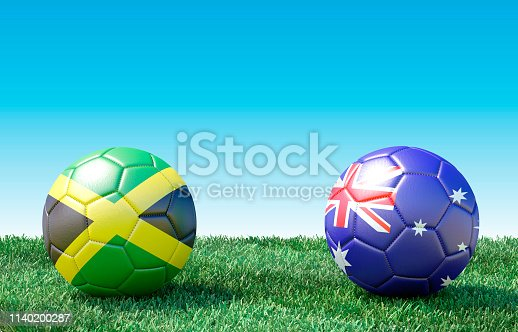istock Two soccer balls in flags colors on green grass. Jamaica and Australia 1140200287
