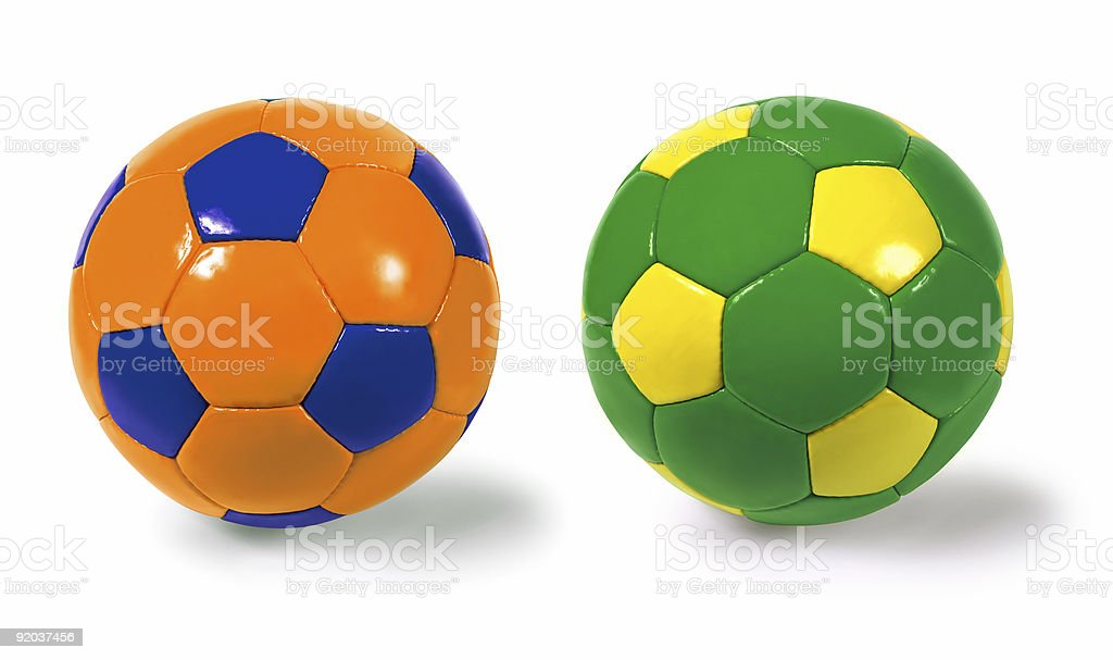 Photograph of two isolated soccer balls - different colour...