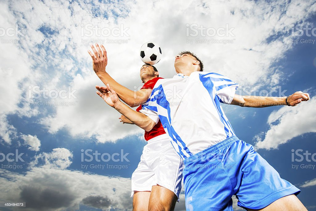 Two soccer players against sky. royalty-free stock photo