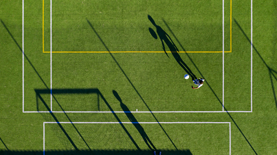 Birds eye view of two boys in action playing soccer/football.