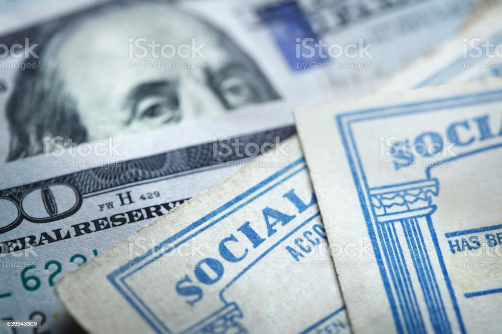 Two Social Security Cards On Top Of $100 Bills stock photo