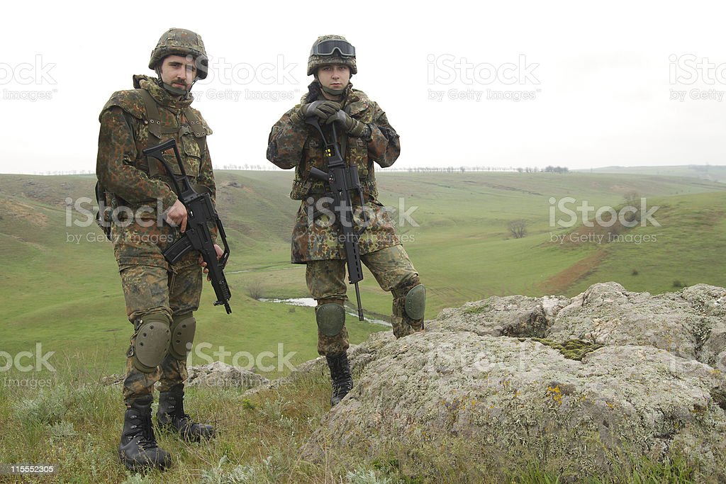 Two soldiers on the rock royalty-free stock photo