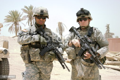 istock Two soldiers posing on camera in the middle east 157186552