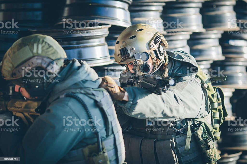 Two soldiers scout the area occupied by the enemy stock photo