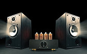 istock Two sound speakers with vacuum tube amplifier 1249855230