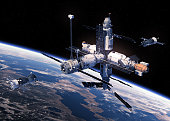 istock Two Spacecraft Is Preparing To Dock With Space Station 887249958