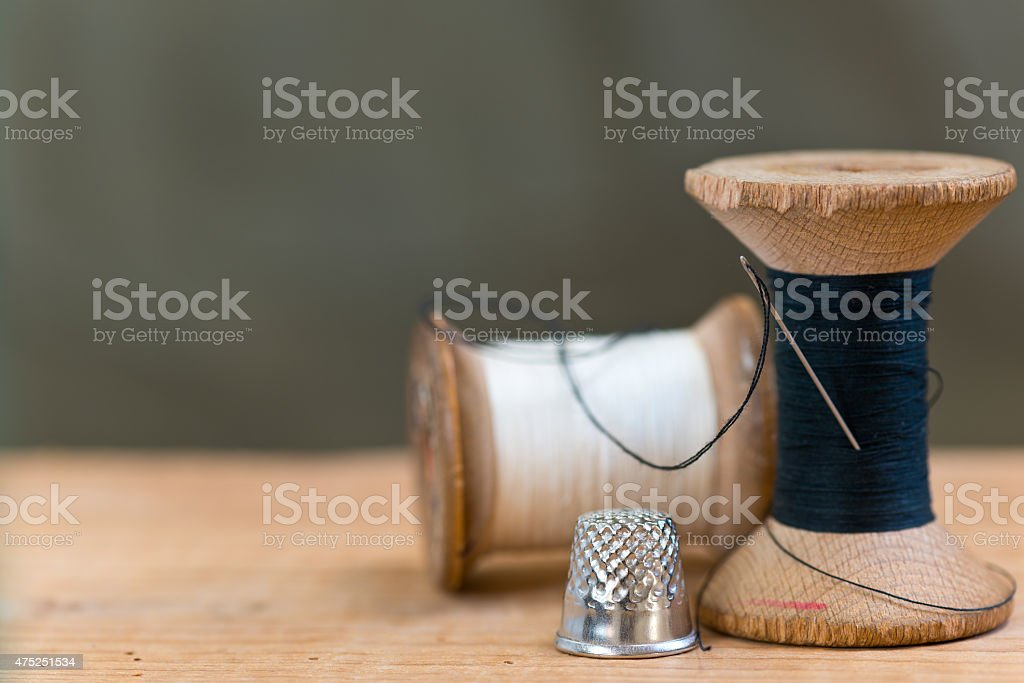 two spools of thread stock photo