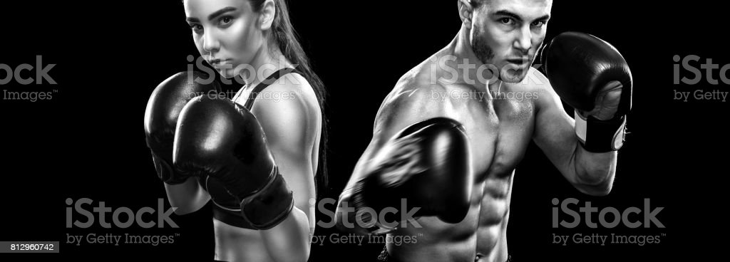 Two sportsmans boxers on black background. Copy Space. Sport concept. stock photo