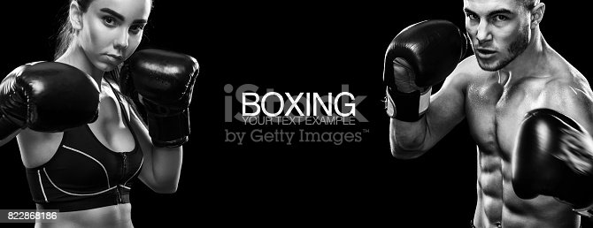 istock Two sportsmans boxers on black background. Copy Space. Sport concept. 822868186