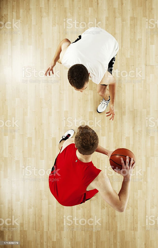 Two sportsmen playing basketball stock photo