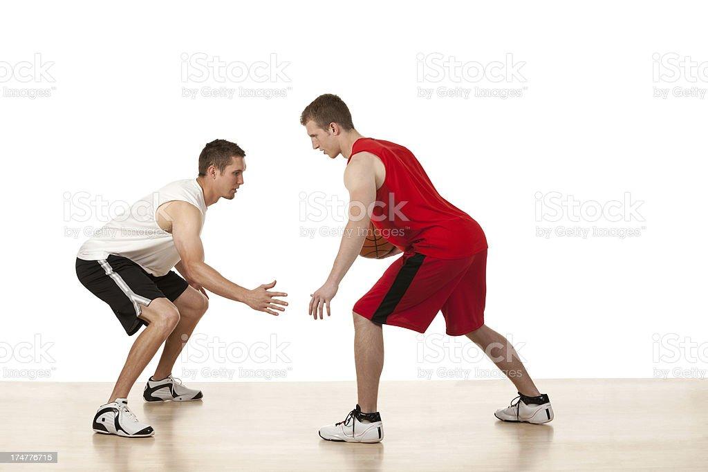 Two sportsmen playing basketball royalty-free stock photo