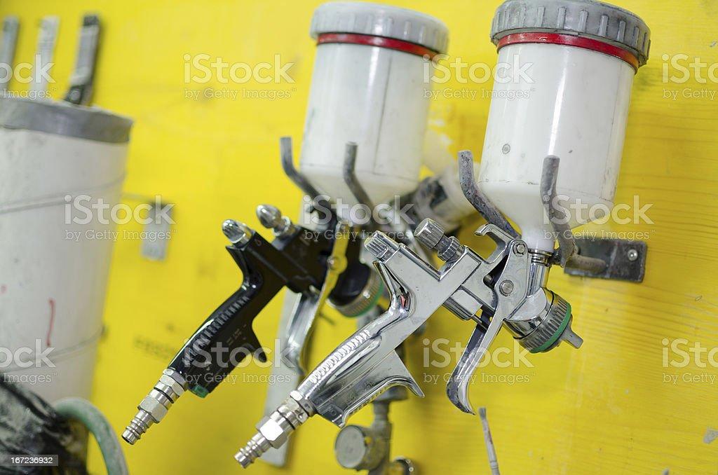 Two spray guns stock photo