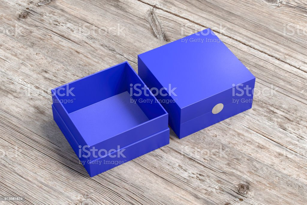 Two blue square boxes opened and closed on wood background. 3d...