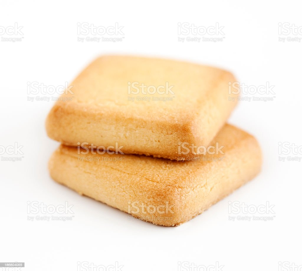 Two square shortbread cookies on a white background royalty-free stock photo