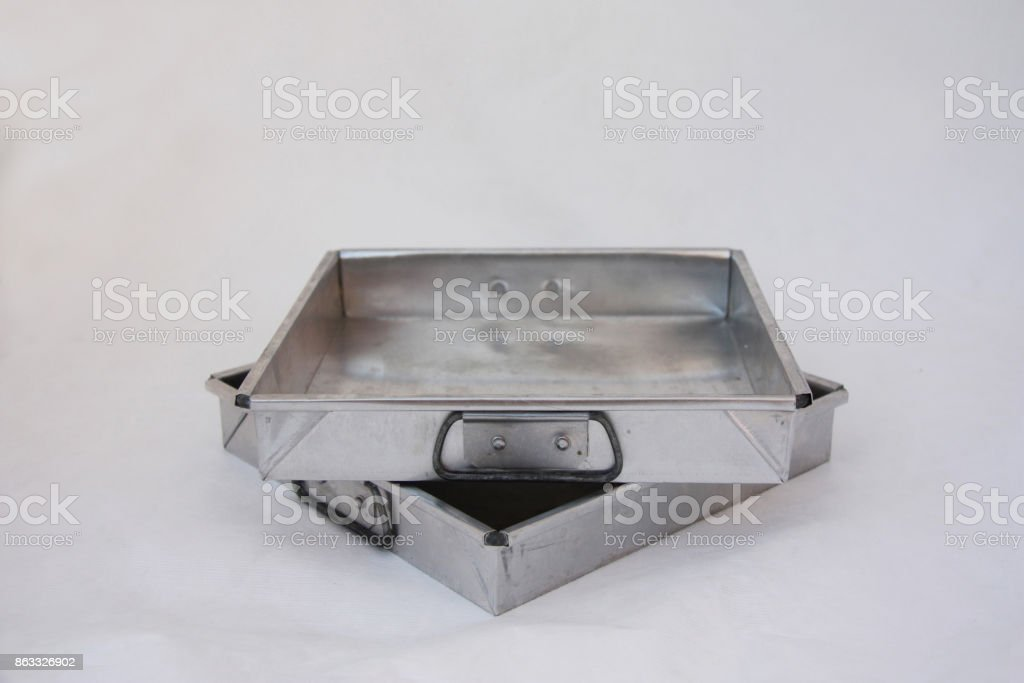 Two square zinc mold cake stacked on the white background. stock photo