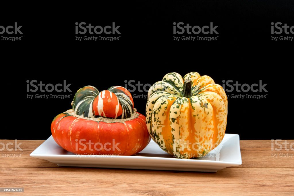 Two squash vegetables against a black background. royalty-free stock photo