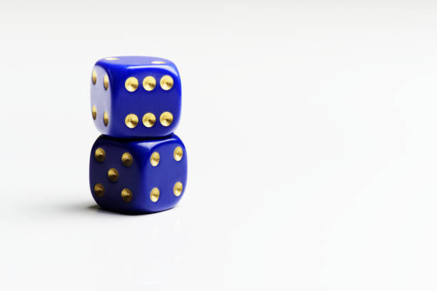 Two stacked dices on white background stock photo