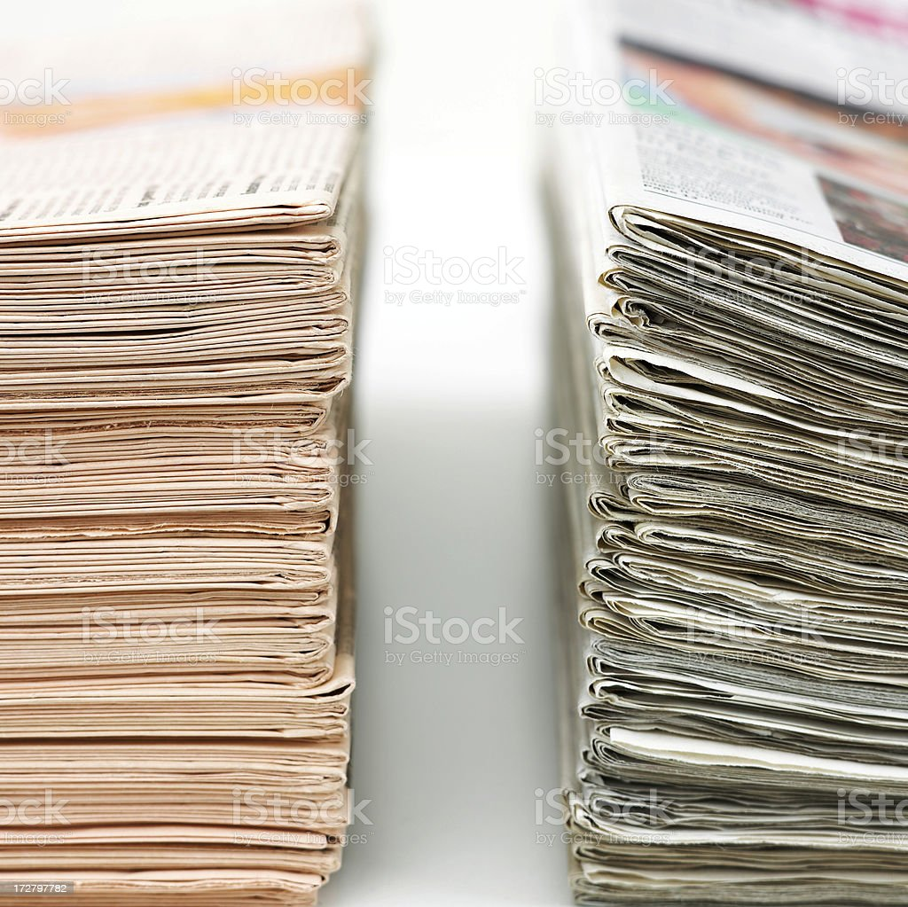 Two stacks of newspapers royalty-free stock photo