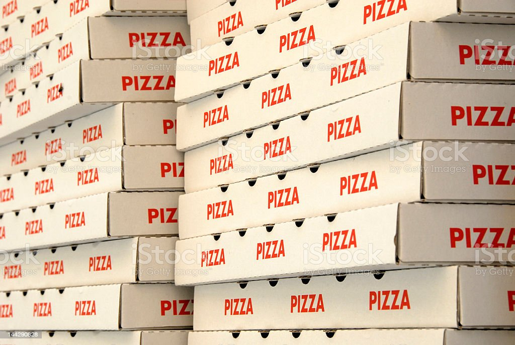 Two stacks of red and white pizza boxes stock photo