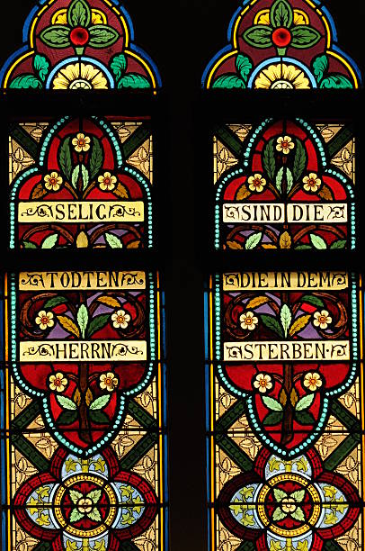 Two Stained Glass Window Panels in Northern Church stock photo