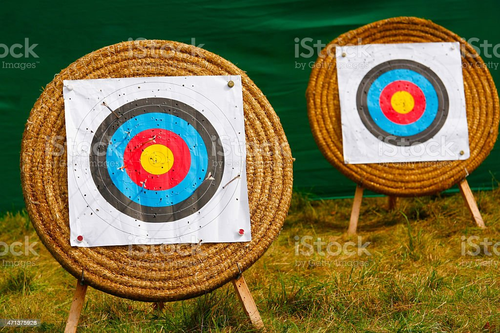 Two stands for archery with bows and holes stock photo