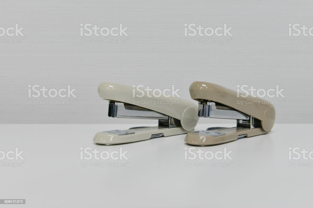 Two stapler is on the white table stock photo