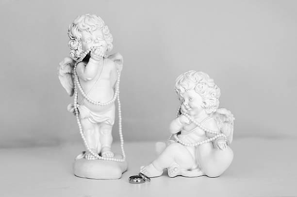 two statues of angels - schmuck engel stock-fotos und bilder