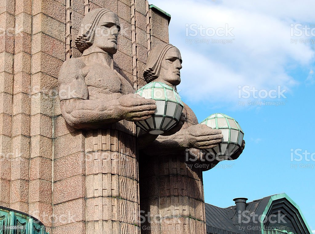 Two statues of  men with lamps. royalty-free stock photo