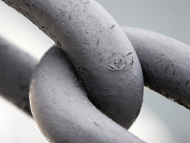 Two steel chains joined together for a strong connection stock photo
