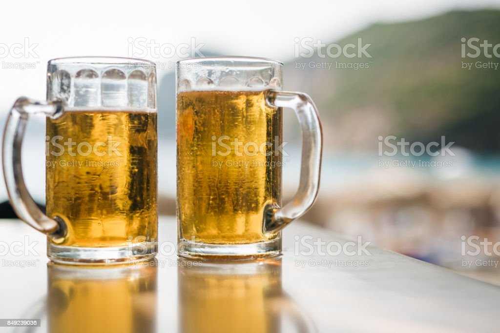 Two steins of beer stock photo