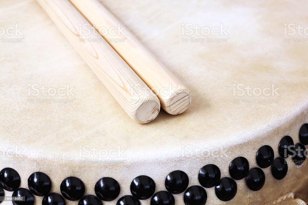 Two sticks on Japanese taiko drum stock photo