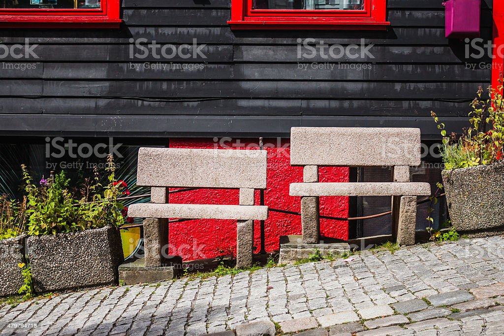 Two stone benches on the street in Bergen stock photo