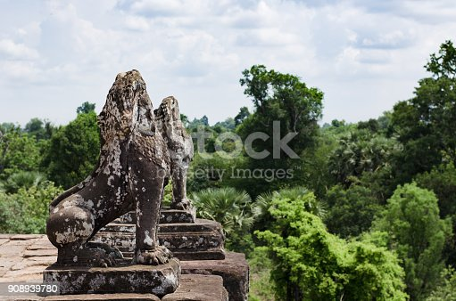 istock Two stone lions guarding Pre Rup temple terrace in Angkor Wat 908939780